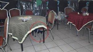 Polis baskınında masanın altına saklandı: Ayakkabımı bağlıyordum